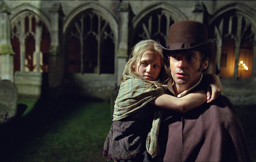 """FILE - This publicity film image released by Universal Pictures shows Hugh Jackman as Jean Valjean holding Isabelle Allen as Young Cosette in a scene from """"Les Miserables."""" Best-picture prospects for Oscar Nominations on Thursday, Jan. 10, 2013, include """"Les Miserables,"""" directed by Tom Hooper.  (AP Photo/Universal Pictures, Laurie Sparham, File)"""