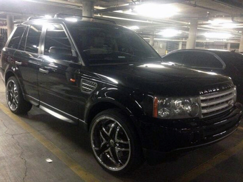 This photo provided by the Las Vegas Metropolitan Police Department shows a black Range Rover SUV in Las Vegas that was found Saturday, Feb. 23, 2013, at an apartment complex east of the Las Vegas Strip. It has been impounded as evidence in connection with a shooting that sent a Maserati into a taxi that exploded, killing three people. Police are looking for 26-year-old Ammar Harris in connection with the shooting. (AP Photo/Las Vegas Metropolitan Police Department)