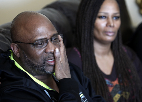 Kenneth Cherry Sr., left, wipes his face during a news conference in Las Vegas on Saturday, Feb. 23, 2013, regarding the death of his son Kenny Cherry, as his sister Becky Cherry watches. Kenneth Cherry Jr., was driving a Maserati that was peppered by gunfire before it sped through a red light and smashed into a taxi driven by Michael Boldon carrying passenger Sandra Sutton-Wasmund. All three involved in the crash were killed and the  coroner said Cherry died of a gunshot to the chest. (AP Photo/Las Vegas Review-Journal, John Locher)