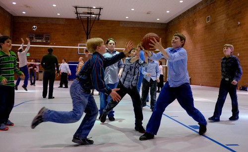 Trent Nelson  |  The Salt Lake Tribune Boys race for a loose basketball as a group of FLDS members recreate at El Capitan School, Sunday, February 17, 2013 in Colorado City.