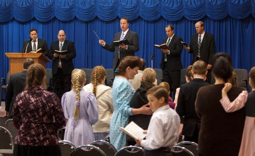 Trent Nelson  |  The Salt Lake Tribune Sam Allred leads a congregation of FLDS members in a hymn during church services Sunday, February 17, 2013 in Hildale. Left to right on stage are William E. Jessop, Garth Warner, Allred, Dan Timpson and Royce Jessop
