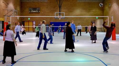 Trent Nelson  |  The Salt Lake Tribune A group of FLDS members play volleyball and basketball at El Capitan High School, Sunday, February 17, 2013 in Colorado City.