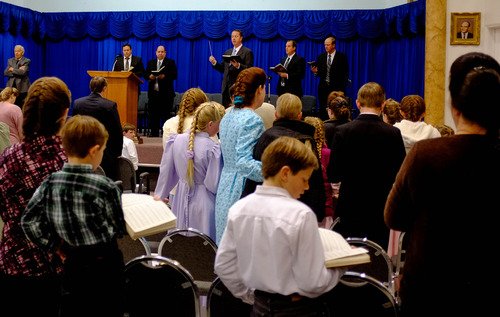 Trent Nelson  |  The Salt Lake Tribune Sam Allred leads a congregation of FLDS members in a hymn during church services Sunday, February 17, 2013 in Hildale.