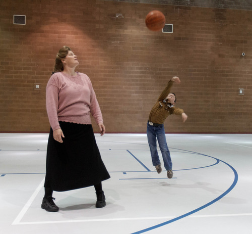 Trent Nelson  |  The Salt Lake Tribune Nathan Jessop launches a shot while his mother Joanna Jessop looks on as a group of FLDS members gather to recreate at El Capitan School, Sunday, February 17, 2013 in Colorado City.