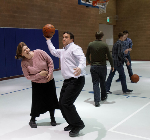 Trent Nelson  |  The Salt Lake Tribune William E. Jessop puts up a basketball shot over his wife Joanna Jessop as a group of FLDS members gather to recreate at El Capitan High School, Sunday, February 17, 2013 in Colorado City.