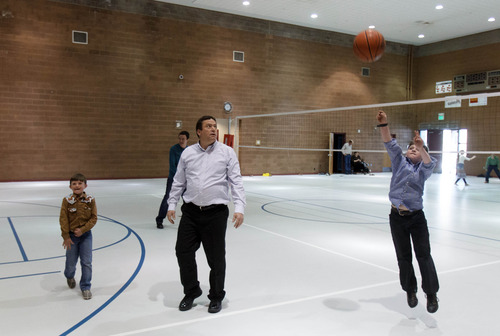 Trent Nelson  |  The Salt Lake Tribune William E. Jessop plays basketball with his sons Nathan and Jared as a group of FLDS members gather to recreate at El Capitan School, Sunday, February 17, 2013 in Colorado City.