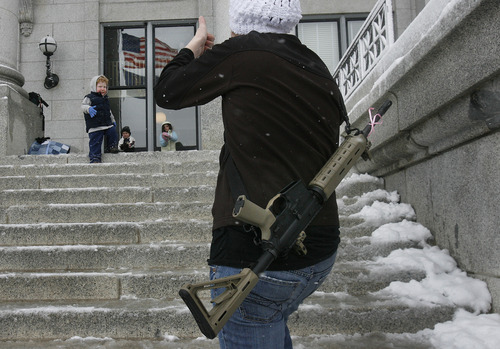 """Scott Sommerdorf      The Salt Lake Tribune Serie Davidson makes photos of her children on the steps of the Utah state Capitol at a pro-gun rally as part of the """"National Day of Resistance"""" Saturday, February 23, 2013."""