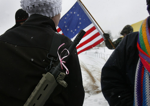 """Scott Sommerdorf      The Salt Lake Tribune Serie Davidson had a pink ribbon tied to the barrel of her rifle as she and about 200 other gun-rights activists rallied at the Utah Capitol as part of the """"National Day of Resistance"""" Saturday, February 23, 2013."""