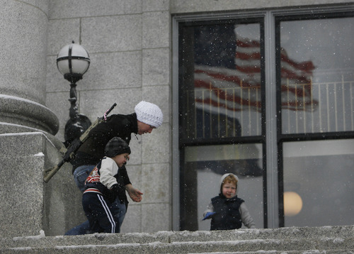 """Scott Sommerdorf      The Salt Lake Tribune Serie Davidson gathers her children on the steps of the Utah state Capitol as she attended a pro-gun rally as part of the """"National Day of Resistance"""" Saturday, February 23, 2013."""