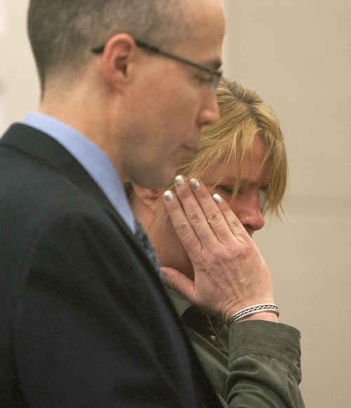 Steve Griffin | The Salt Lake Tribune  Kristine Biggs, who was shot in the eye by a Morgan County police officer after leading them on a chase, wipes tears away as she stands with her attorney, Michael Edwards, during her sentencing hearing for charges related to the incident at the Davis County Justice Complex  in Farmington, Utah Monday February 25, 2013.
