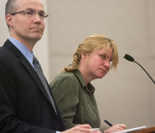 Steve Griffin | The Salt Lake Tribune  Kristine Biggs, who was shot in the eye by a Morgan County police officer after leading them on a chase, stands with her attorney, Michael Edwards, during her sentencing hearing for charges related to the incident at the Davis County Justice Complex  in Farmington, Utah Monday February 25, 2013.