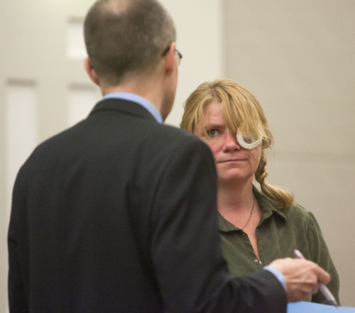Steve Griffin | The Salt Lake Tribune  Kristine Biggs, who was shot in the eye by a Morgan County police officer after leading them on a chase, talks with her attorney, Michael Edwards, during her sentencing hearing for charges related to the incident at the Davis County Justice Complex  in Farmington, Utah Monday February 25, 2013.
