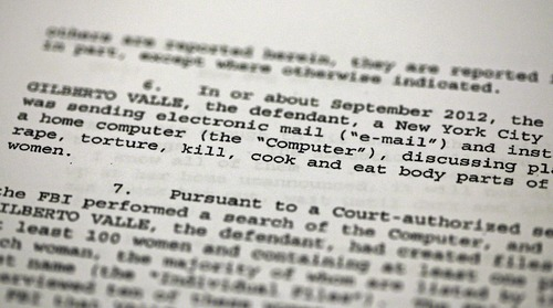 """FILE - This Oct. 25, 2012 file photo shows a passage of a Federal complaint filed in New York, against New York City Police Department officer Gilberto Valle. Valle is accused of kidnapping conspiracy and admits to thinking about abducting, cooking and devouring young women. His own lawyer has shown prospective jurors a kinky staged photo of a woman trussed up in a roasting pan to test their tolerance for the officer's """"weird proclivities."""" (AP Photo/Richard Drew, File)"""