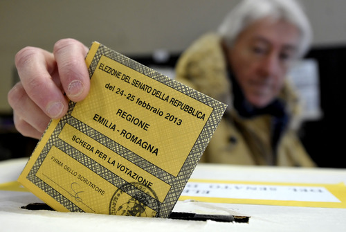 A man casts his vote for the Italian Senate, in Piacenza, Italy, Sunday, Feb. 24, 2013. Italy votes in a watershed parliamentary election Sunday and Monday that could shape the future of one of Europe's biggest economies. (AP Photo/Marco Vasini)