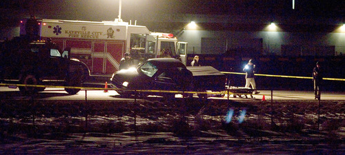 Paul Fraughton  |   Salt Lake Tribune What appears to be the body of a man involved in a high speed chase on Interstate 15 lies on the ground behind a black pickup truck   Monday, February 25, 2013