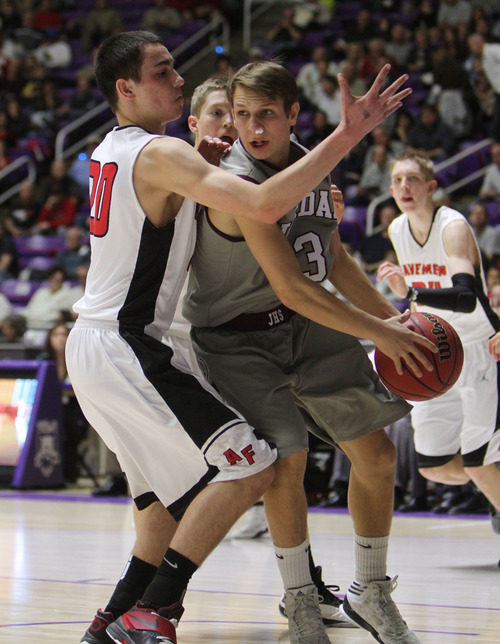 Francisco Kjolseth  |  The Salt Lake Tribune Jordan's Chandler Smith tries to get a ball past Brayden Harris of American Fork at the Dee Events Center at Weber State on Monday, February 25, 2013.