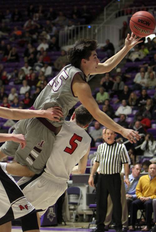 Francisco Kjolseth  |  The Salt Lake Tribune Marcus Gutierrez of Jordan tries to stretch one in past American Fork at the Dee Events Center at Weber State on Monday, February 25, 2013.