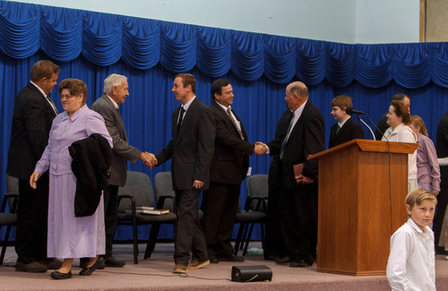 Trent Nelson  |  The Salt Lake Tribune Congregants cross the stage shaking hands with church leaders following a church service of FLDS members Sunday, February 17, 2013 in Hildale.