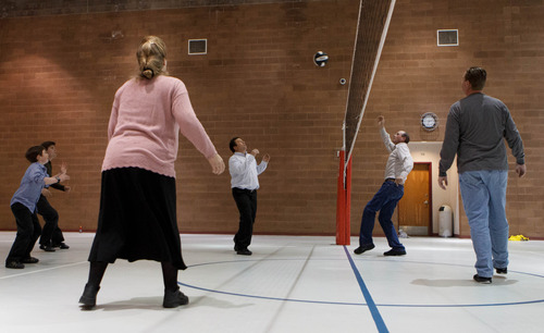 Trent Nelson  |  The Salt Lake Tribune FLDS members play play volleyball at El Capitan School, Sunday, February 17, 2013 in Colorado City. William E. Jessop at center, Royce Jessop and Sam Allred at right.
