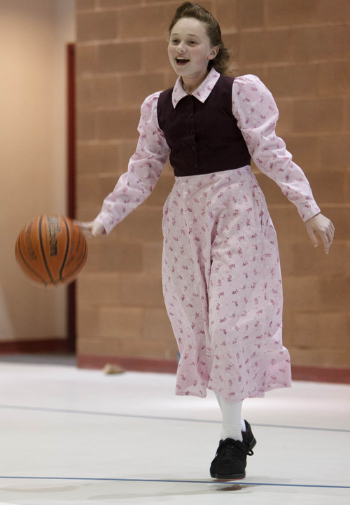 Trent Nelson  |  The Salt Lake Tribune Janey Timpson dribbles the basketball as a group of FLDS members gather to recreate at El Capitan School, Sunday, February 17, 2013 in Colorado City, Ariz.