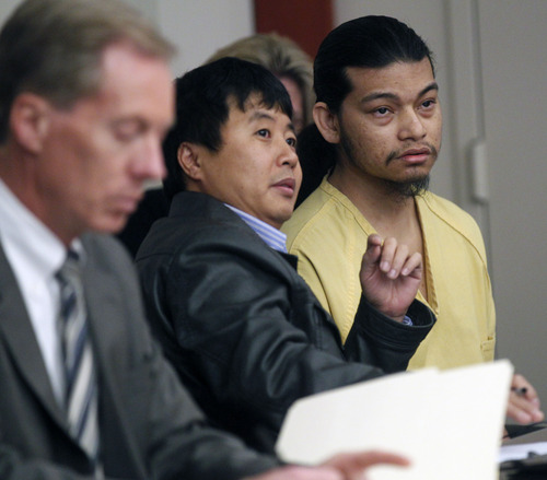 Al Hartmann  |  The Salt Lake Tribune Esar Met, accused of killing 7-year-old Hser Ner Moo in 2008 sits at the defense table with his lawyer and interpreter in Judge William Barrett's 3rd District Court in Salt Lake City in November for his preliminary hearing.