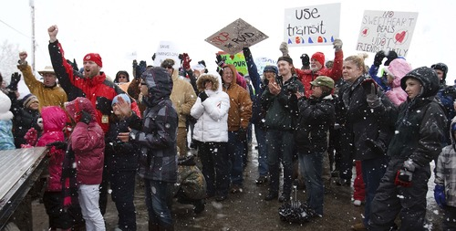 Leah Hogsten  |  The Salt Lake Tribune West Davis Corridor, February 23, 2013. More than 100 people lined Glovers Lane in Farmington for the milelong protest made up of farm equipment, airboats, bikes and citizens with the message: STOP UDOT from building West Davis Corridor through Farmington Bay area.SaveFarmington.org, a citizen's group in Farmington held a rally to protest the proposed
