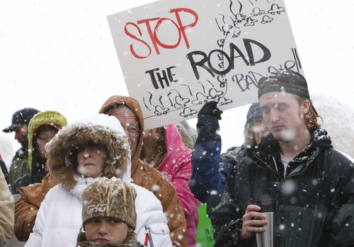 Leah Hogsten  |  The Salt Lake Tribune SaveFarmington.org, a citizens group in Farmington, held a rally to protest the proposed West Davis Corridor, February 23, 2013. More than 100 people lined Glovers Lane in Farmington for the milelong protest made up of farm equipment, air boats, bikes and citizens with the message: STOP UDOT from building West Davis Corridor through Farmington Bay area.