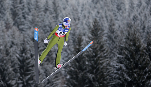 Sarah Hendrickson of the United States  soars through the air during the women's ski jumping HS 106 Individual at the Nordic Ski World Championships in Val di Fiemme, Italy, Friday, Feb. 22, 2013.  (AP Photo/Matthias Schrader)