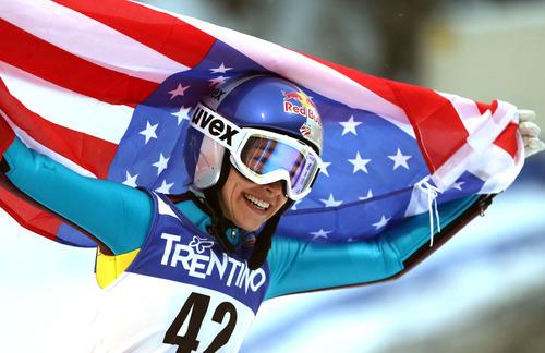 Utahn Sarah Hendrickson celebrates after winning the women's ski jumping HS 106 Individual at the Nordic Ski World Championships in Val di Fiemme, Italy, Friday, Feb. 22, 2013.  (AP Photo/Matthias Schrader)