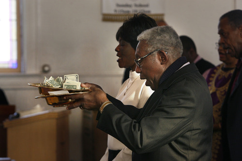 Scott Sommerdorf   |  The Salt Lake Tribune The offering is prayed over during the Founders Day celebration at Trinity AME Community Church, Sunday, February 23, 2013.