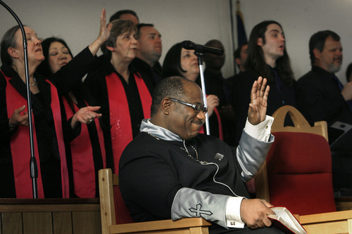 Scott Sommerdorf   |  The Salt Lake Tribune Pastor Charles T. Wright reacts to the singing of the choir during the Founders Day celebration at Trinity AME Community Church, Sunday, February 23, 2013.