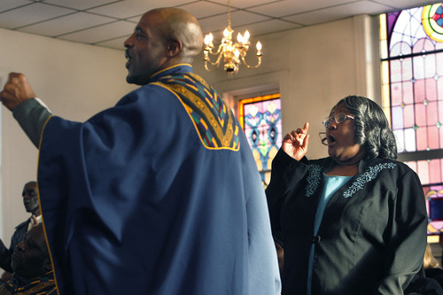 Scott Sommerdorf   |  The Salt Lake Tribune Trinity AME Church choir member Kevin Nelson claps and moves to the music of the Ebenezer Church of God in Christ choir along with the rest of the congregation at Trinity AME Church in Salt Lake City during Founders Day service Sunday, February 23, 2013.