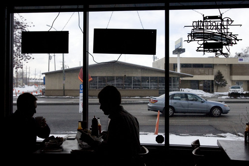 Kim Raff     The Salt Lake Tribune Customers (left) Josh Jensen and (right) Jeff Jensen eat in the dining room at Sugarhouse BBQ Company in Salt Lake City on Friday, February 22, 2013. Sugarhouse BBQ Company is moving to 2100 S. 900 East. The owners say the trolley project will cut down on their parking so they will be forced to move from their current location at 2207 S. 700 East.