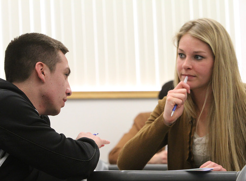 Rick Egan    The Salt Lake Tribune   Chris Quintana (left) and Kaitlin Wright (right) discuss a paper in their creative writing class at BYU, Friday, February 22, 2013. Quintana's family exemplifies intergenerational poverty, but with a lot of outside support Quintana has managed to break out of it. He served an LDS mission and now attends BYU.