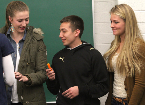 Rick Egan    The Salt Lake Tribune   Hailey Ingram (left) jokes with Chris Quintana (center) and Kaitlin Wright (right) in their creative writing class at BYU, Friday, February 22, 2013. Quintana's family exemplifies intergenerational poverty, but with a lot of outside support Quintana has managed to break out of it. He served an LDS mission and now attends BYU.