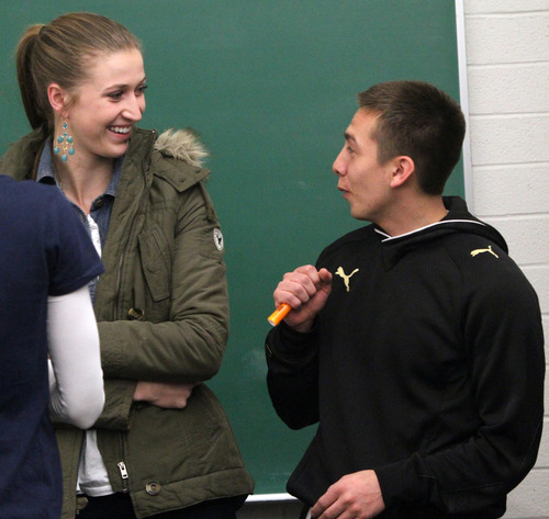 Rick Egan    The Salt Lake Tribune   Hailey Ingram (left) jokes with Chris Quintana (right)  in their creative writing class at BYU, Friday, February 22, 2013. Quintana's family exemplifies intergenerational poverty, but with a lot of outside support Quintana has managed to break out of it. He served an LDS mission and now attends BYU.