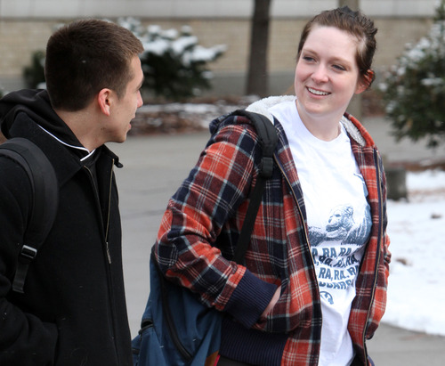 Rick Egan    The Salt Lake Tribune   Chris Quintana walks to class with Kelli Lippard, on the BYU campus in Provo, Friday, February 22, 2013. Quintana's family exemplifies intergenerational poverty, but with a lot of outside support Quintana has managed to break out of it. He served an LDS mission and now attends BYU.