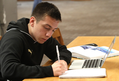 Rick Egan    The Salt Lake Tribune   Chris Quintana studies in the library between classes at BYU, Friday, February 22, 2013. Quintana's family exemplifies intergenerational poverty, but with a lot of outside support Quintana has managed to break out of it. He served an LDS mission and now attends BYU.