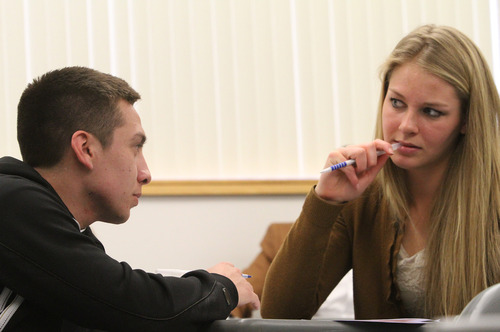 Rick Egan    The Salt Lake Tribune   Chris Quintana (left) and Kaitlin Wright (right) discuss their assignment in their creative writing class at BYU, Friday, February 22, 2013. Quintana's family exemplifies intergenerational poverty, but with a lot of outside support Quintana has managed to break out of it. He served an LDS mission and now attends BYU.