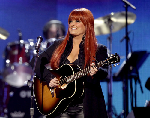 "FILE - This April 4, 2011 file photo shows country singer Wynonna Judd from The Judds, performing at the Girls' Night Out: Superstar Women of Country in Las Vegas. Judd  is one of eleven celebrity contestants who will compete on the next edition of ""Dancing with the Stars."" The new season kicks off on ABC with a two-hour premiere on March 18. (AP Photo/Julie Jacobson, file)"