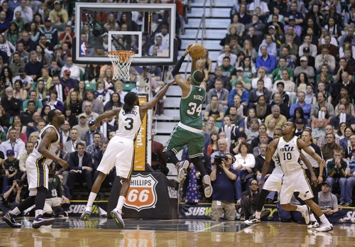 Boston Celtics' Paul Pierce (34) shoots as Utah Jazz's DeMarre Carroll (3) defends in overtime during an NBA basketball game Monday, Feb. 25, 2013, in Salt Lake City.  Celtics defeated the Jazz 110-107. (AP Photo/Rick Bowmer)