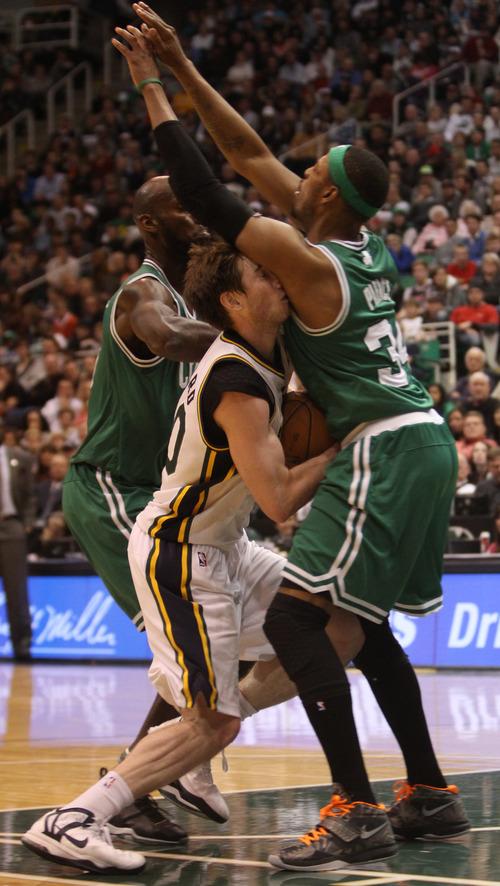Rick Egan    The Salt Lake Tribune   Utah Jazz shooting guard Gordon Hayward (20) is fouled by Boston Celtics small forward Paul Pierce (34), in NBA action at the EnergySolutions Arena,  Monday, February 25, 2013.