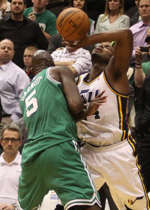 Rick Egan    The Salt Lake Tribune   Utah Jazz power forward Paul Millsap (24) is fouled by Boston Celtics power forward Kevin Garnett (5) with 4.2 seconds left on the clock, in NBA action at the EnergySolutions Arena,  Monday, February 25, 2013.