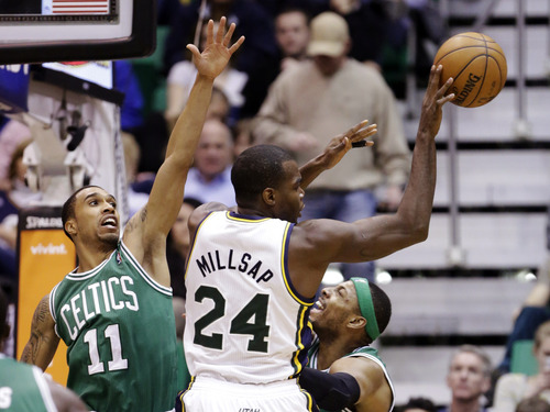 Boston Celtics' Courtney Lee (11) and Paul Pierce, right, defend against Utah Jazz's Paul Millsap (24) in the second quarter during an NBA basketball game, Monday, Feb. 25, 2013, in Salt Lake City. (AP Photo/Rick Bowmer)