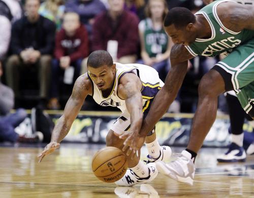 Utah Jazz's Earl Watson (11) and Boston Celtics' Brandon Bass (30) chase after a loose ball in the first quarter during an NBA basketball game, Monday, Feb. 25, 2013, in Salt Lake City. (AP Photo/Rick Bowmer)