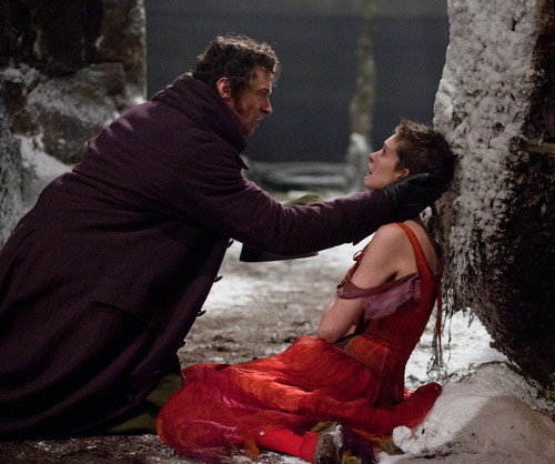 """This film image released by Universal Pictures shows Hugh Jackman as Jean Valjean, left, and Anne Hathaway as Fantine in a scene from """"Les Miserables."""" (AP Photo/Universal Pictures, Laurie Sparham)"""