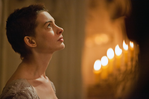 """This film image released by Universal Pictures shows actress Anne Hathaway portraying Fantine, a struggling, sickly mother forced into prostitution in 1800s Paris, in a scene from the screen adaptation of """"Les Miserables.""""  (AP Photo/Universal Pictures, Laurie Sparham)"""