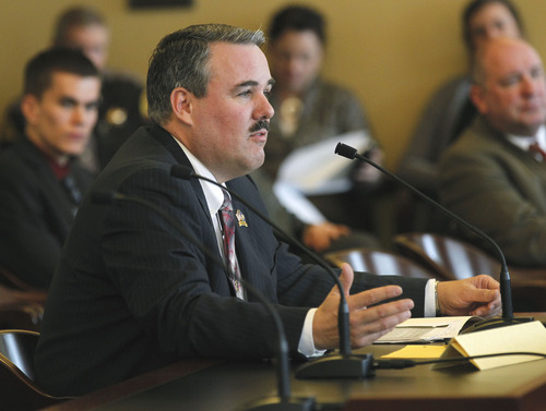 Al Hartmann  |  The Salt Lake Tribune Rep. Lee Perry, R-Perry, a Utah Highway Patrol trooper speaks in the House Transportation Committee Tuesday February 26 for passage of HB283 which would make not buckling up a primary offense on freeways and any roads with speed limit over 55.
