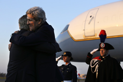 U.S. Secretary of State John Kerry embraces his long time friend, U.S. Ambassador to Italy David Thorne, left, as Kerry arrives at Ciampino Airport, in Rome on Wednesday, Feb. 27, 2013. where talks on Syria will be held. Rome is the fourth leg of Kerry's first official overseas trip, a hectic nine-day dash through Europe and the Middle East. (AP Photo/Jacquelyn Martin, Pool)