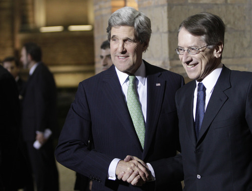 U.S. Secretary of State John Kerry shakes hands with Italian Foreign Minister Giulio Terzi, right, as he arrives at Villa Madama in Rome, Wednesday, Feb. 27, 2013. Kerry will attend an international conference on Syria in Rome Thursday. The United States is looking for more tangible ways to support Syria's rebels and bolster a fledgling political movement that is struggling to deliver basic services after nearly two years of civil war, Kerry said Wednesday. (AP Photo/Riccardo De Luca)
